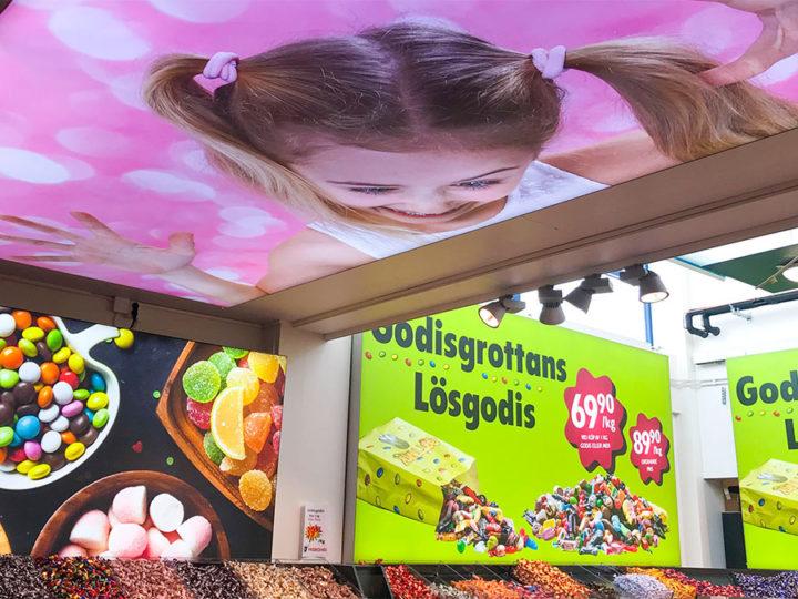 Bildsatta ljuslådor skapar lekfull butiksmiljö hos Matpiraten